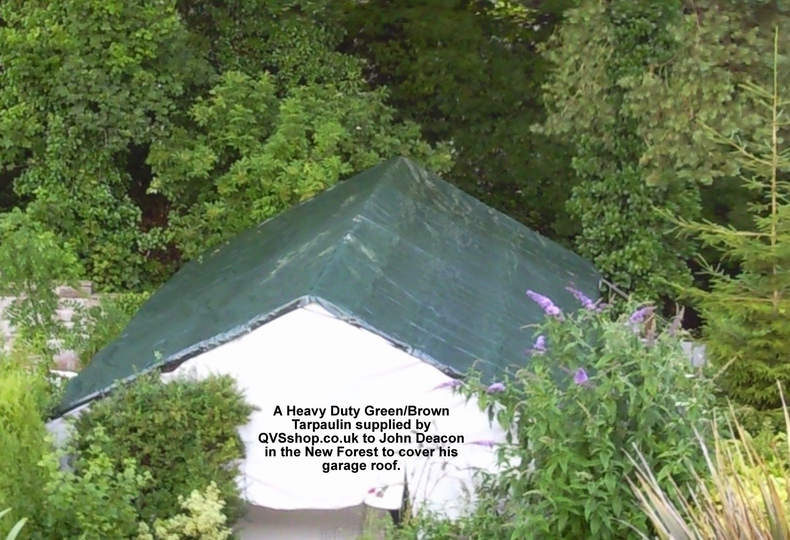 Green brown tarpaulin on roof